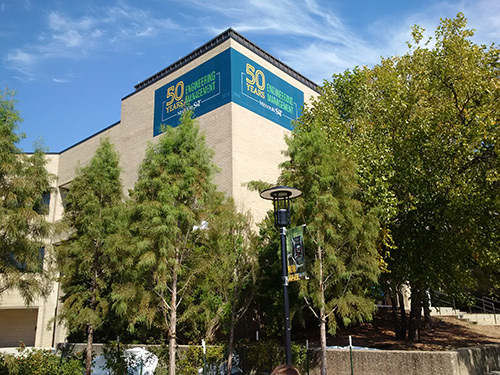 Photo showing the Engineering Management 50th Anniversary banner on the walls of Engineering Management Building